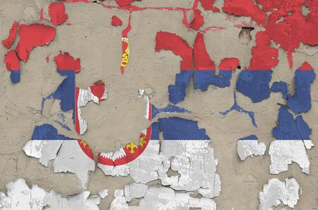 Serbia flag depicted in paint colors on old obsolete messy concrete wall close up. Textured banner on rough background