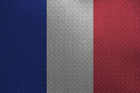 France flag depicted in paint colors on old brushed metal plate or wall close up. Textured banner on rough background