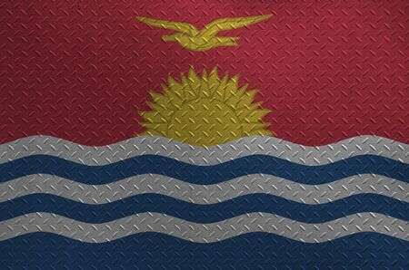 Kiribati flag depicted in paint colors on old brushed metal plate or wall close up. Textured banner on rough background