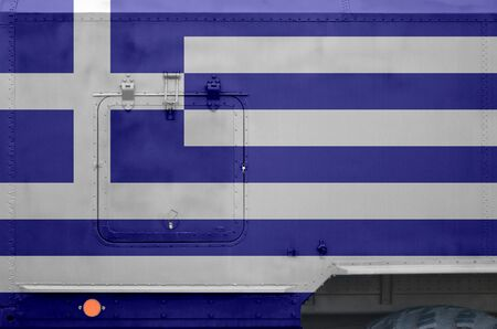 Greece flag depicted on side part of military armored truck close up. Army forces vehicle conceptual background