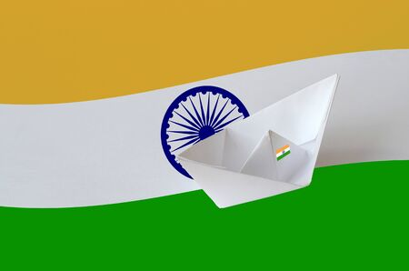 India flag depicted on paper origami ship closeup. Oriental handmade arts concept
