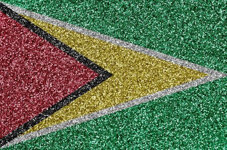 Guyana flag depicted on many small shiny sequins. Colorful festival background for disco party