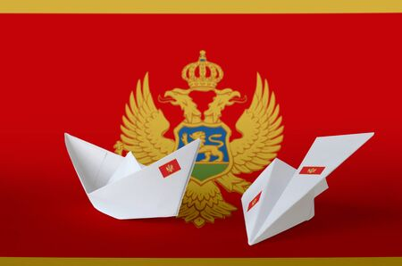 Montenegro flag depicted on paper origami airplane and boat. Oriental handmade arts concept Stock Photo