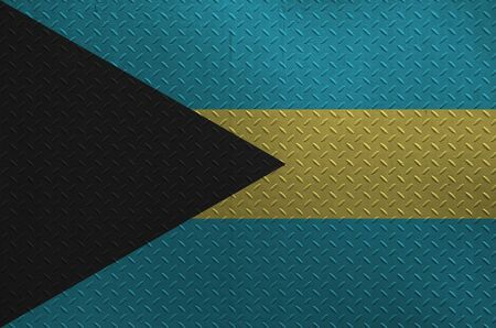 Bahamas flag depicted in paint colors on old brushed metal plate or wall close up. Textured banner on rough background