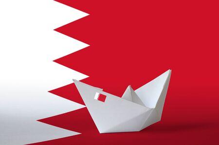 Bahrain flag depicted on paper origami ship closeup. Oriental handmade arts concept