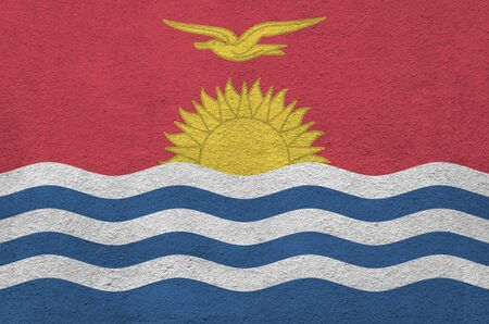 Kiribati flag depicted in bright paint colors on old relief plastering wall close up. Textured banner on rough background Stock fotó