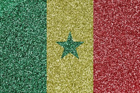 Senegal flag depicted on many small shiny sequins. Colorful festival background for disco party Stock Photo