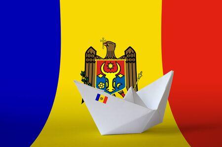 Moldova flag depicted on paper origami ship closeup. Oriental handmade arts concept