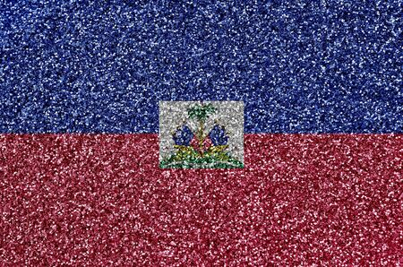 Haiti flag depicted on many small shiny sequins. Colorful festival background for disco party