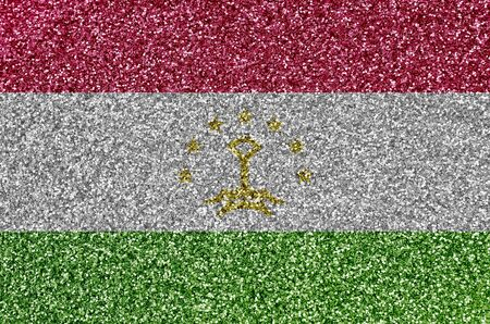 Tajikistan flag depicted on many small shiny sequins. Colorful festival background for disco party Stock fotó