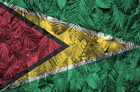 Guyana flag depicted on many leafs of monstera palm trees. Trendy fashionable background