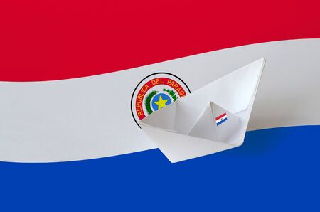 Paraguay flag depicted on paper origami ship closeup. Oriental handmade arts concept