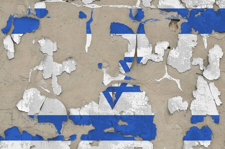 Israel flag depicted in paint colors on old obsolete messy concrete wall close up. Textured banner on rough background