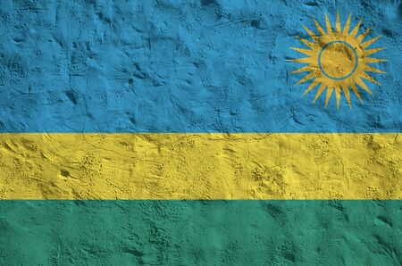 Rwanda flag depicted in bright paint colors on old relief plastering wall close up. Textured banner on rough background Foto de archivo