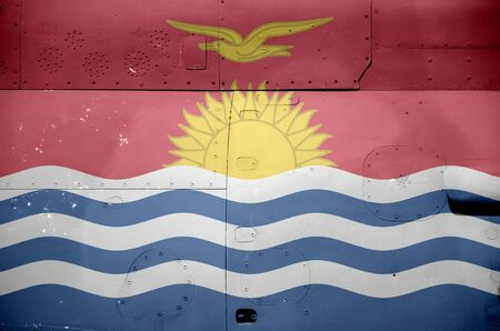 Kiribati flag depicted on side part of military armored helicopter close up. Army forces aircraft conceptual background