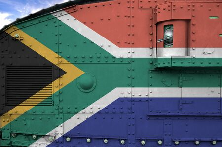 South Africa flag depicted on side part of military armored tank close up. Army forces conceptual background