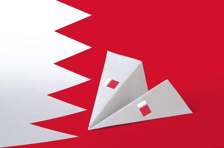 Bahrain flag depicted on paper origami airplane. Oriental handmade arts concept Reklamní fotografie