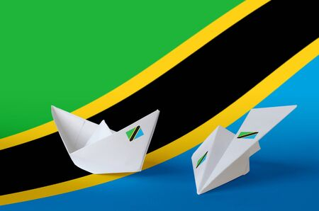 Tanzania flag depicted on paper origami airplane and boat. Oriental handmade arts concept Stock fotó
