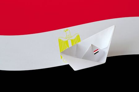 Egypt flag depicted on paper origami ship closeup. Oriental handmade arts concept