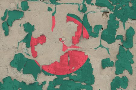 Bangladesh flag depicted in paint colors on old obsolete messy concrete wall close up. Textured banner on rough background