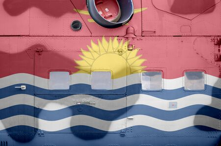 Kiribati flag depicted on side part of military armored helicopter close up. Army forces aircraft conceptual background Stock fotó