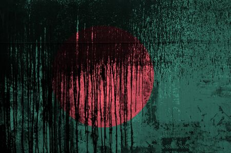 Bangladesh flag depicted in paint colors on old and dirty oil barrel wall close up. Textured banner on rough background