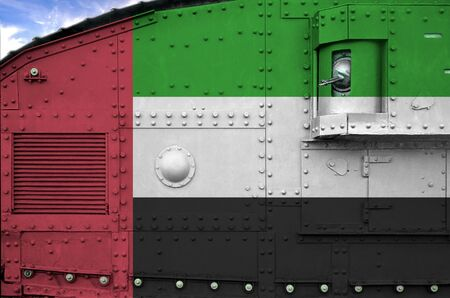 United Arab Emirates flag depicted on side part of military armored tank close up. Army forces conceptual background Banco de Imagens