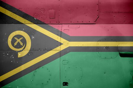 Vanuatu flag depicted on side part of military armored helicopter close up. Army forces aircraft conceptual background