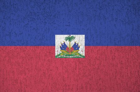 Haiti flag depicted in bright paint colors on old relief plastering wall close up. Textured banner on rough background Stock fotó
