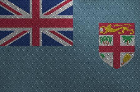 Fiji flag depicted in paint colors on old brushed metal plate or wall close up. Textured banner on rough background