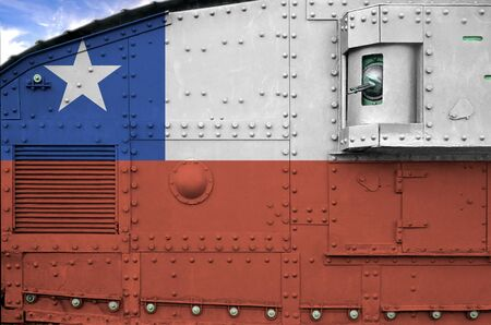 Chile flag depicted on side part of military armored tank close up. Army forces conceptual background Stock fotó