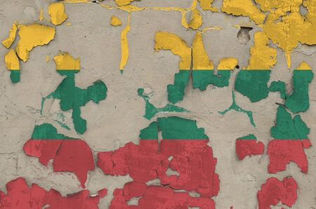 Lithuania flag depicted in paint colors on old obsolete messy concrete wall close up. Textured banner on rough background Reklamní fotografie