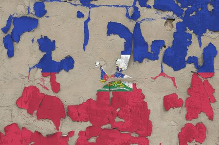Haiti flag depicted in paint colors on old obsolete messy concrete wall close up. Textured banner on rough background 写真素材