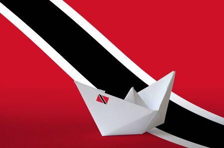 Trinidad and Tobago flag depicted on paper origami ship closeup. Oriental handmade arts concept