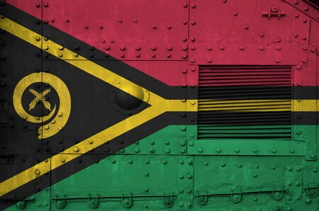 Vanuatu flag depicted on side part of military armored tank close up. Army forces conceptual background Banco de Imagens