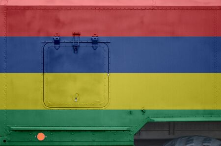 Mauritius flag depicted on side part of military armored truck close up. Army forces vehicle conceptual background Banque d'images