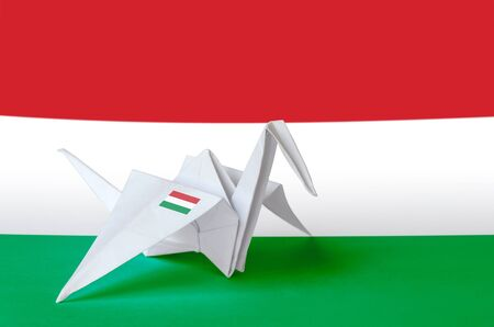 Hungary flag depicted on paper origami crane wing. Oriental handmade arts concept