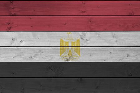 Egypt flag depicted in bright paint colors on old wooden wall close up. Textured banner on rough background Banco de Imagens