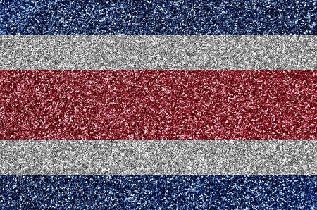 Costa Rica flag depicted on many small shiny sequins. Colorful festival background for disco party Stock fotó