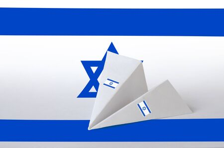 Israel flag depicted on paper origami airplane. Oriental handmade arts concept
