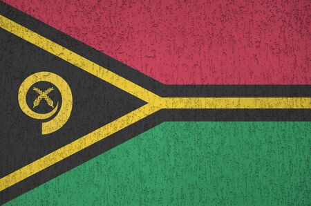 Vanuatu flag depicted in bright paint colors on old relief plastering wall close up. Textured banner on rough background