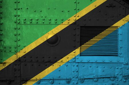 Tanzania flag depicted on side part of military armored tank close up. Army forces conceptual background