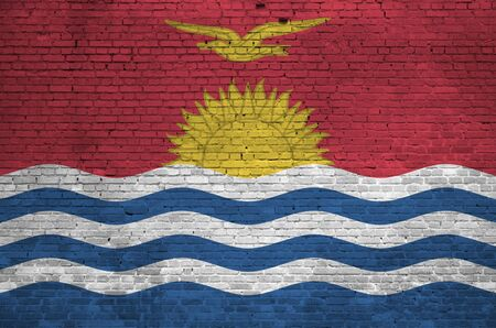 Kiribati flag depicted in paint colors on old brick wall close up. Textured banner on big brick wall masonry background Stock fotó