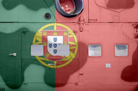 Portugal flag depicted on side part of military armored helicopter close up. Army forces aircraft conceptual background Stock fotó