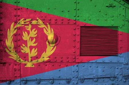 Eritrea flag depicted on side part of military armored tank close up. Army forces conceptual background