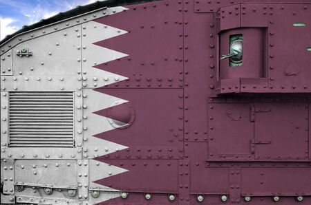 Qatar flag depicted on side part of military armored tank close up. Army forces conceptual background Фото со стока
