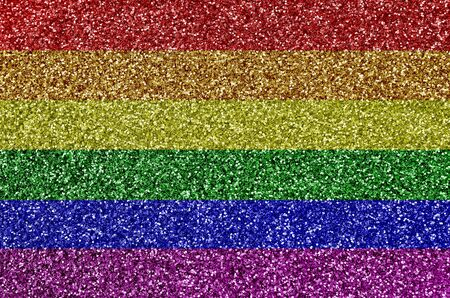 LGBT community flag depicted on many small shiny sequins. Colorful festival background for disco party Фото со стока