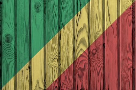 Congo flag depicted in bright paint colors on old wooden wall close up. Textured banner on rough background Фото со стока