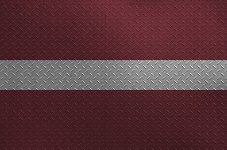 Latvia flag depicted in paint colors on old brushed metal plate or wall close up. Textured banner on rough background Фото со стока
