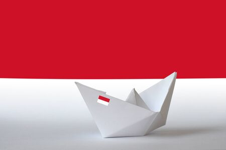 Indonesia flag depicted on paper origami ship closeup. Oriental handmade arts concept